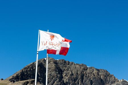 val: Flag of Val DIsere and Savoie waving on the pass