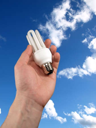 light bulb in the hand on sky background Stock Photo - 4204668