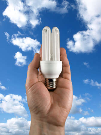 concept of energy saving. light bulb in the hand Stock Photo - 4204669