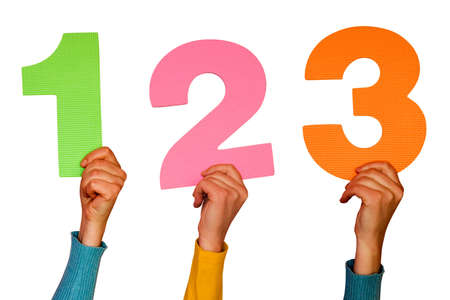 number three: one,two and three colorful numbers at hands Stock Photo
