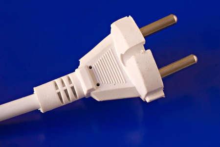 white power plug isolated on blue background photo