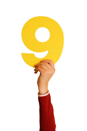number nine in hand,isolated on white background Stock Photo - 6474920