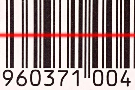 labelling: Laser barcode reader scanning a bar code