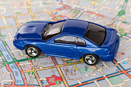tourism concept. small  blue car on Dublin city map Stock Photo - 6552178