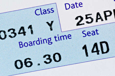 close-up of boarding pass,with time and seat  photo