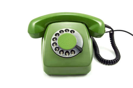 Old green analogue  phone on a white background