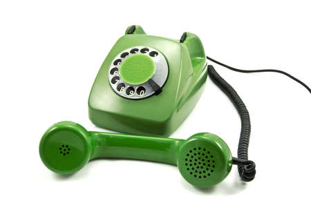 Old-fashioned green analogue phone on a white background photo