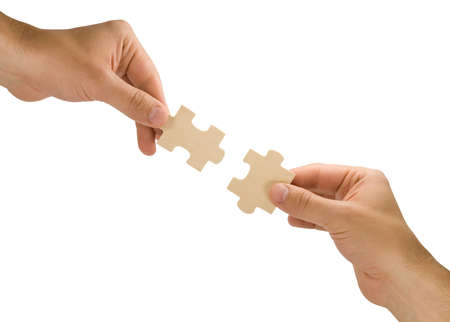 connection concept.  hands with pieces of puzzle on white background Stock Photo - 7295130