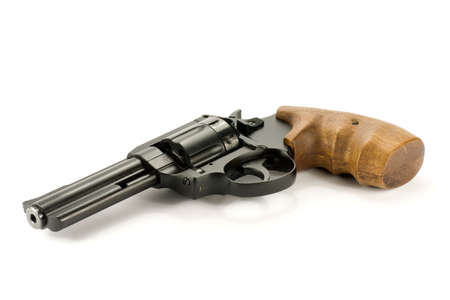 revolver:  black revolver gun isolated on  white background