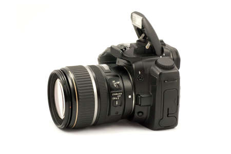dslr camera: semiprofessional digital camera isolated on white background