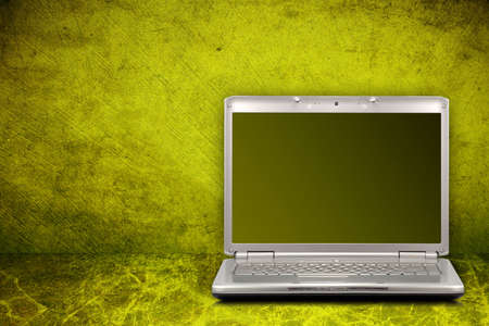 silver computer on green and dirty background Stock Photo - 7340833