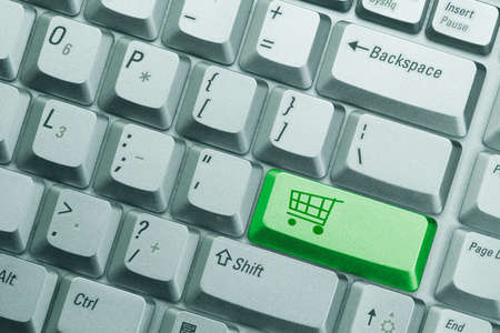 green computer keyboard button with symbol of shopping cart Stock Photo - 7340836