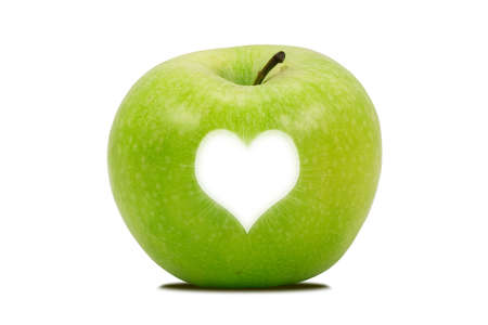 apple with a bright heart shape , isolated over a white background photo