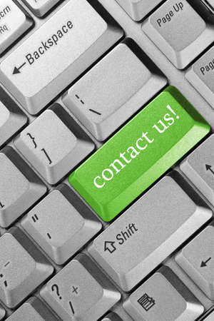 business concept. Keyboard  green key -contact us photo