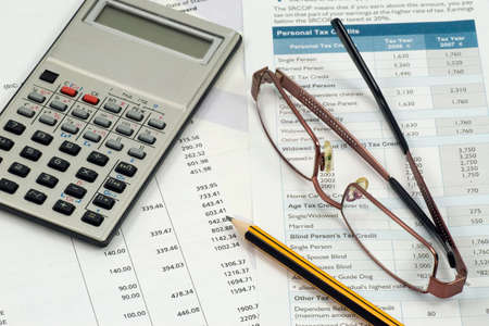 accountant  work space. statement,calculations and expenses Stock Photo - 7455705