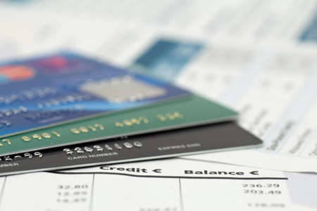 close-up of credit cards on bank invoice photo