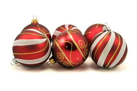 set of christmas baubles over a white background