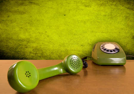 Vintage green telephone on the wooden table Stock Photo - 7698939