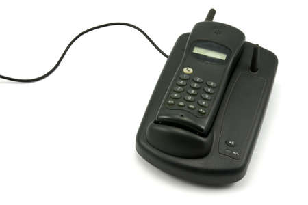 old cordless phone over a white background photo