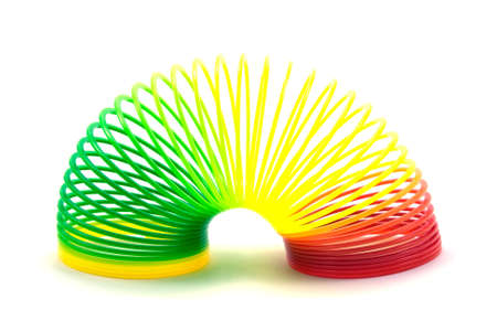 Colorful toy spring isolated on white background photo