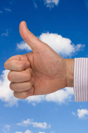 success in business.  thumb up on sky background Stock Photo - 8397131
