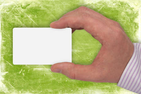 hand with blank card on green background Stock Photo - 8397143