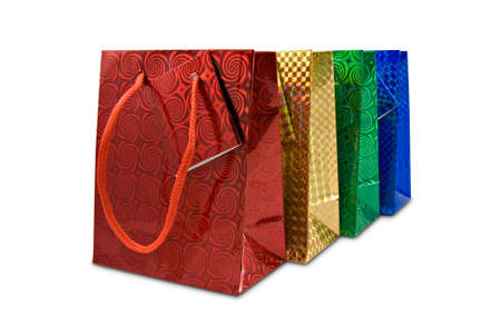 four colorful gifts bags isolated on white background photo