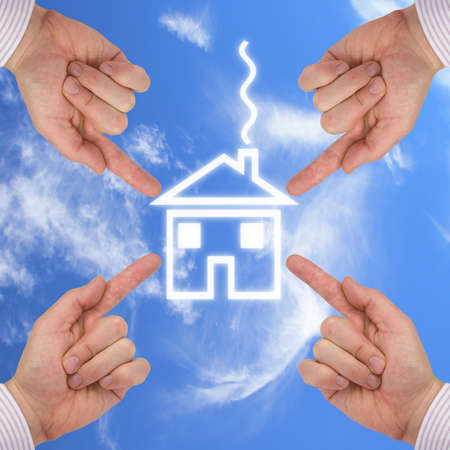 real estate concept. four hands around new house Stock Photo - 8522686