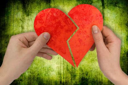 broken relationship: love and divorce. two hands holding broken heart