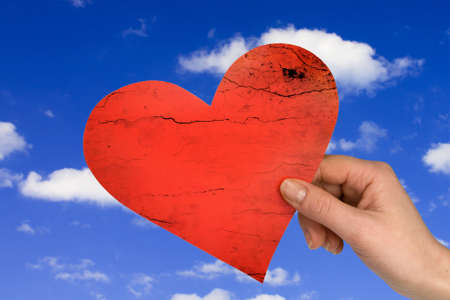 love concept. hand with heart on sky background Stock Photo - 8729554