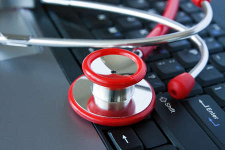Stethoscope on a computer keyboard. Computer technology is an integral part  of medicine, healthcare, and medical/health insurance today. Stock Photo - 9112972