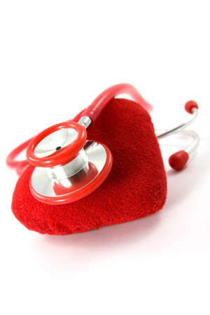 Heart and a stethoscope on white background  Stock Photo - 9112969