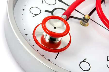 healthy lifestyle. red stethoscope on silver clock