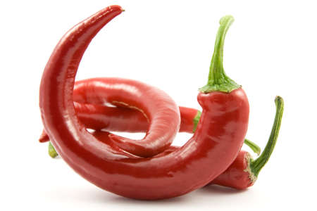 Red chili peppers over a white background Stock Photo - 9160423