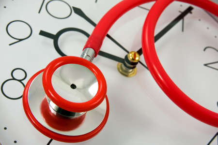 close-up of red stethoscope on silver clock Stock Photo - 9160428