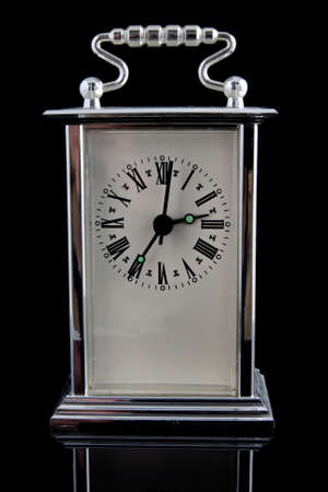 old clock on black background with reflection Stock Photo - 9193400