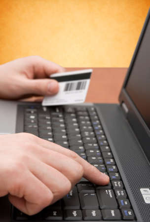 e-commerce concept. hands with credit card on computer keyboard Stock Photo - 9347828
