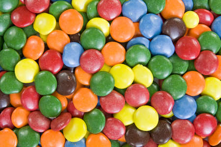 smarties: Background image of sweet smarties or chocolate buttons. Stock Photo