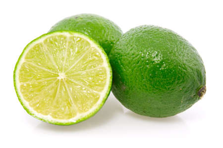 fresh green lemon fruits on a white background.