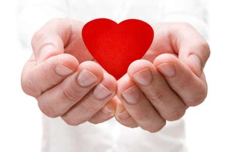 my dear: concetto di amore. in possesso di un cuore rosso nelle mani. Archivio Fotografico