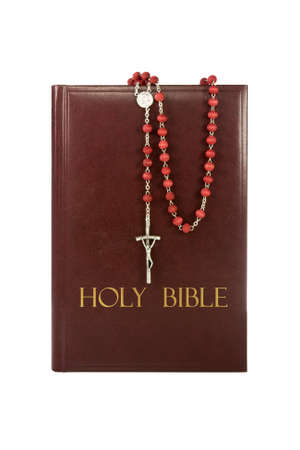 holy bible with rosary isolated on white background. photo