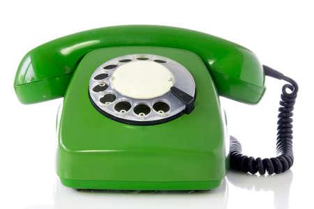 green retro telephone isolated on white background. Stock Photo