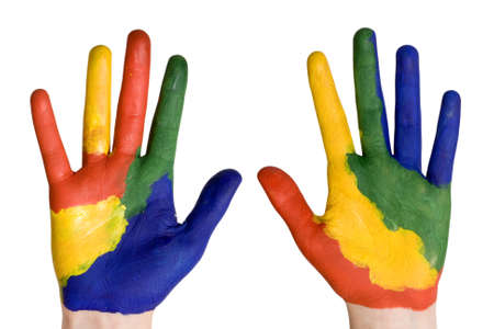 fingerpaint: Child hands painted in colorful paints ready for hand prints.