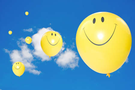 Yellow flying  balloons in a blue sky. Stock Photo - 10114329