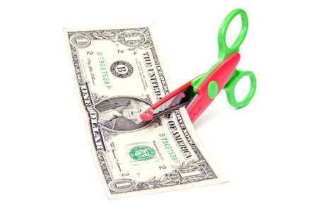 Scissors cuts one american dollar. isolated on white. photo