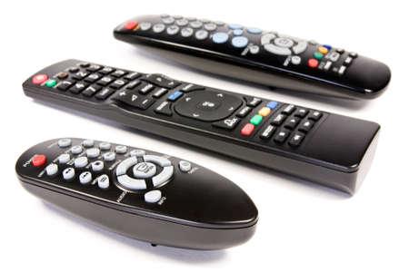 remote controls: three remote controls over a white background Stock Photo