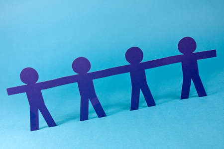 partnership concept. human figures in a row on blue background photo