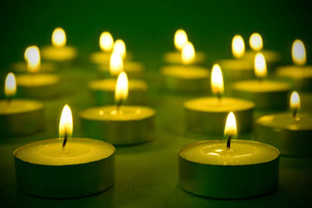 memorial candle: group of warm burning candles on  the darkness