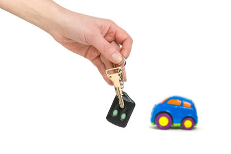 Car and hand with keys isolated on white background  Stock Photo - 11156968