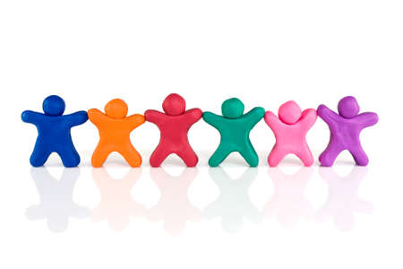 friendship and togetherness. color plasticine people standing in a row Stock Photo - 11156969